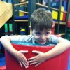 A boy playing on a play set