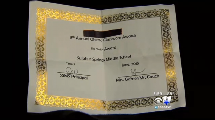 """Photo of """"award"""" given to student"""