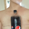 woman holding coke against chest with mastectomy scars showing
