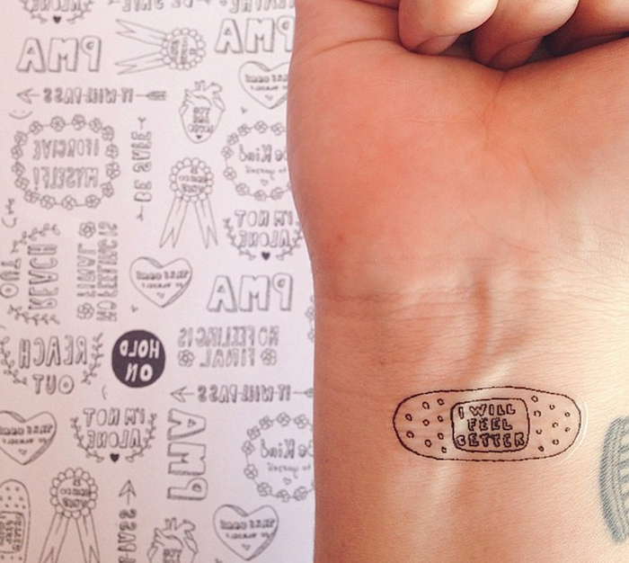 tattoo of a band aid