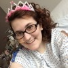 woman in a hospital wearing a crown