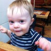 toddler boy sitting at chili's restaurant table