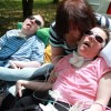 Woman and her daughter and son, who are in wheelchairs.