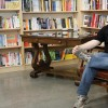 author sitting in library
