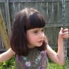 Girl on swing in a backyard