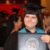 young woman with graduation cap holding diploma
