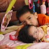 young boy with his little sister