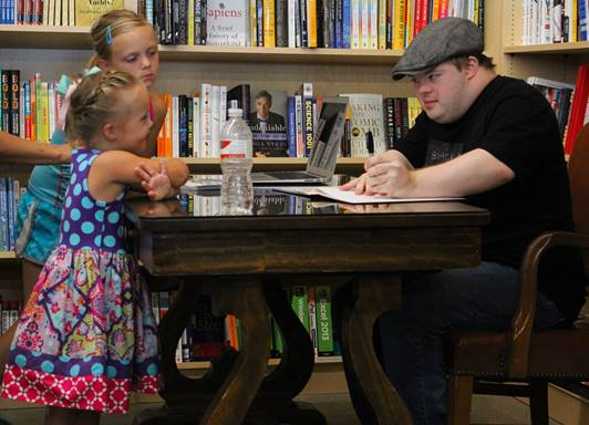 Author and children asking for autographs