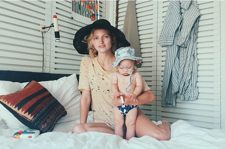 booth and baby on vacation with sun hats