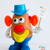 A Mr. Potato Head toy with an earpiece/hearing aid