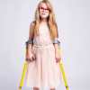 A young girl with cerebral palsy models for camera