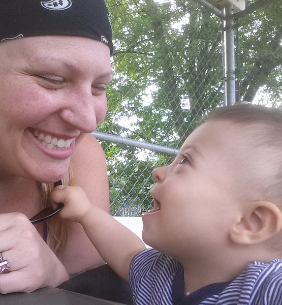 A woman smiling at her son, who had Down syndrome.