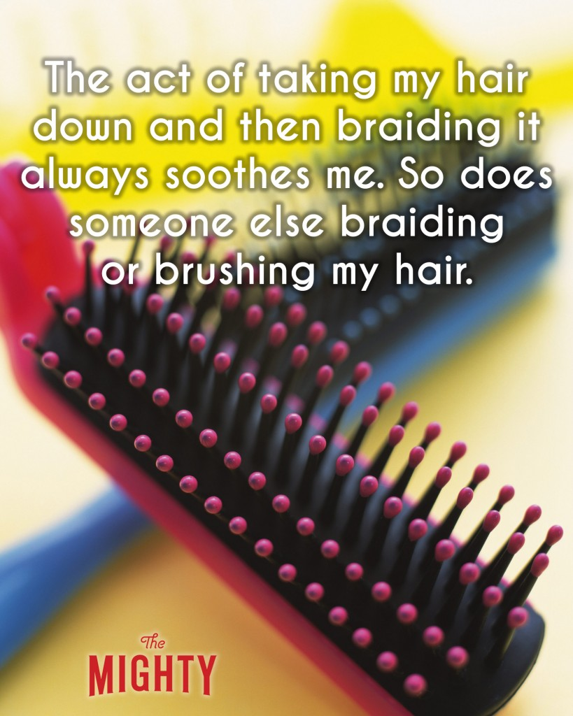 A photo of a pink hair brush on top of a blue hair brush. Accompanying text: [The act of taking my hair down and then braiding it always soothes me. So does someone else braiding or brushing my hair.]