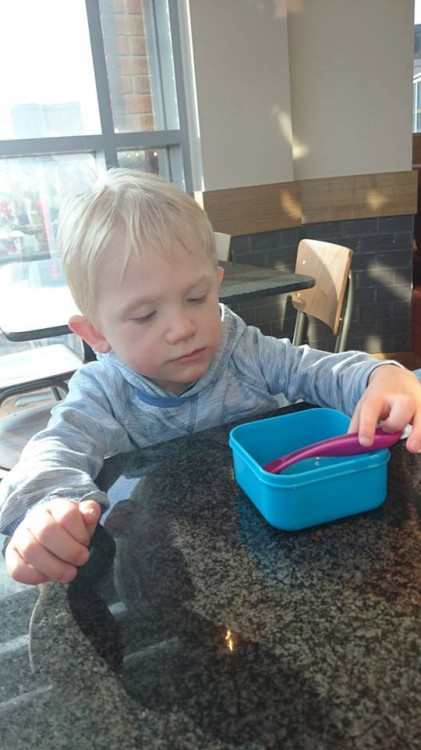Alison's son sitting at the kitchen table