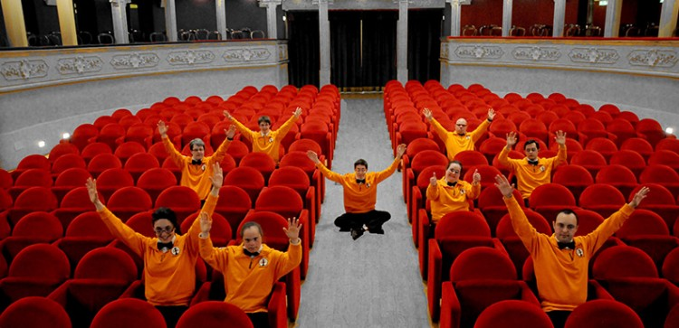 The staff have pose with their hands up in the hotel theater.