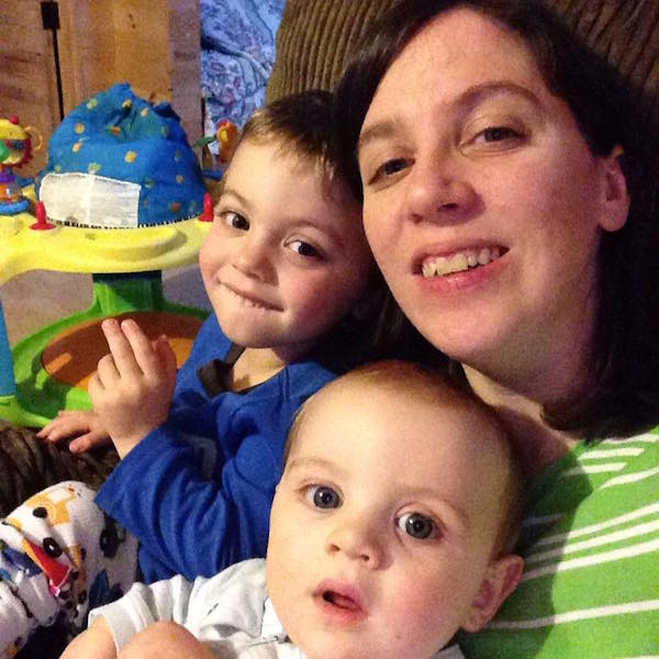 Lori and her two sons sitting together at home