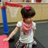 Lyndse's daughter playing next to a small basketball hoop