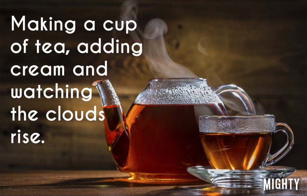 A photo of a teapot and tea cup filled with steaming tea. Accompanying text: [Making a cup of tea, adding cream and watching the clouds rise.]