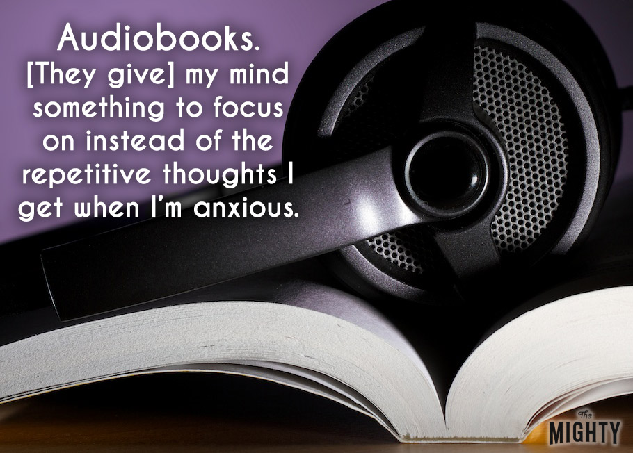 Headphones on a book. Accompanying text: [Audiobooks. [They give] my mind something to focus on instead of the repetitive thoughts I get when I'm anxious.]