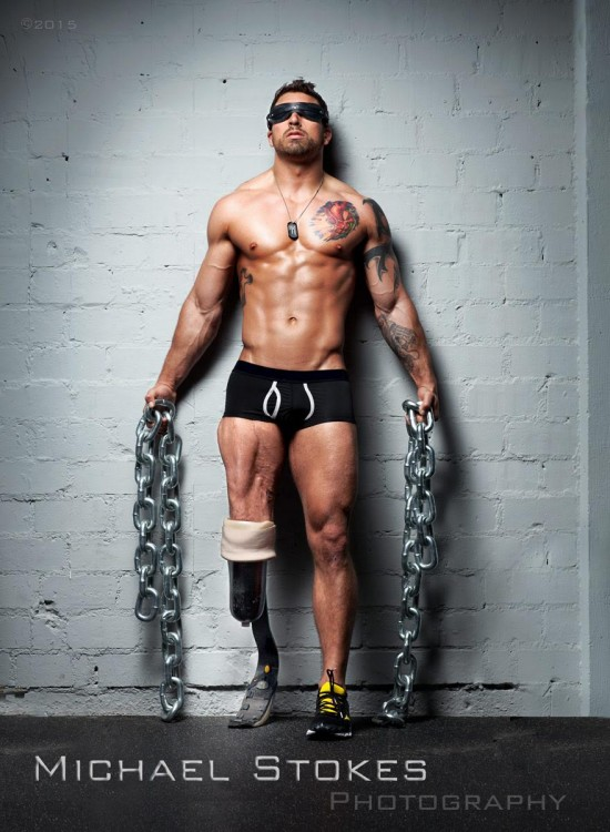 man in his underwear holding chains
