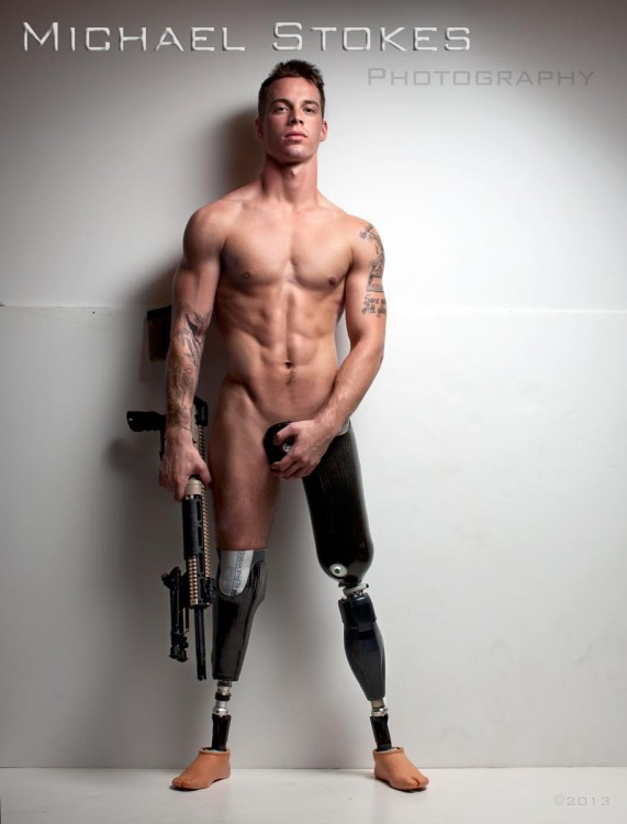 man with double leg amputation holding a weapon