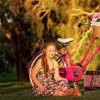 madeline stuart sitting next to bike