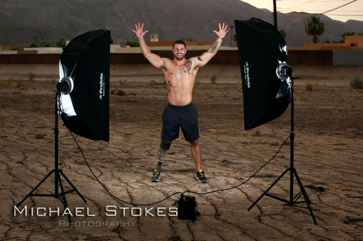 man with prosthetic legs posing for photos
