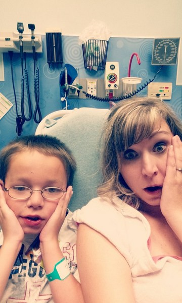 Mom and son sitting in a hospital bed.