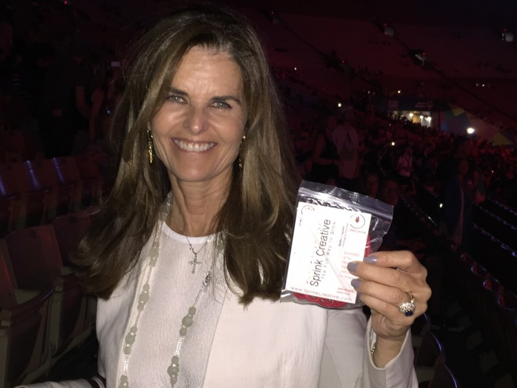 Maria Shriver holding Rocket Laces