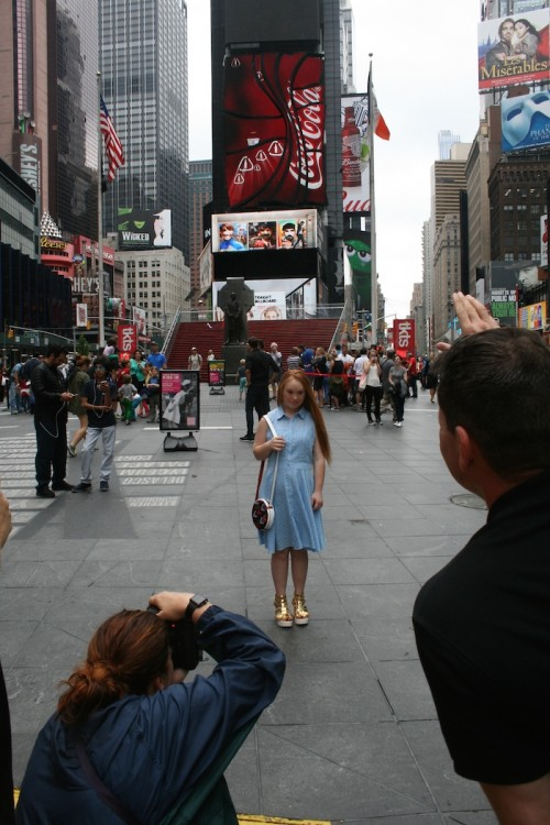 Madeline Stuart on the EverMaya photo shoot in Times Square.