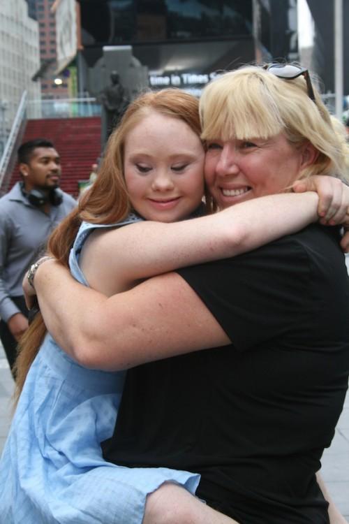 Madeline Stuart hugging her mom, Rosanne Stuart, near Times Square