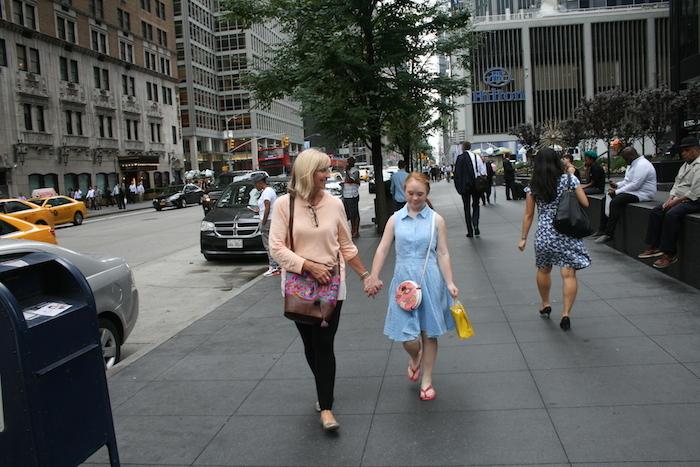 Madeline Stuart and her mom walking down New York street