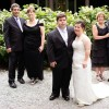Jillian and Ryan in their wedding attire standing with their parents on their wedding day
