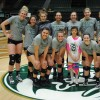 the Colorado State University women's basketball team smiles for the camera with a small girl