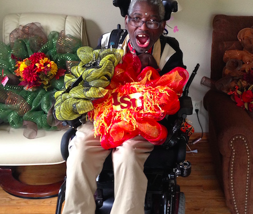 man in wheelchair showing his wreaths