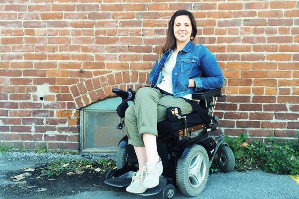 Heidi McKenzie sitting outside in her wheelchair