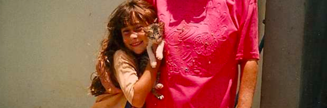young girl with older woman and cat