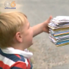 boy receiving stack of envelopes in the mail