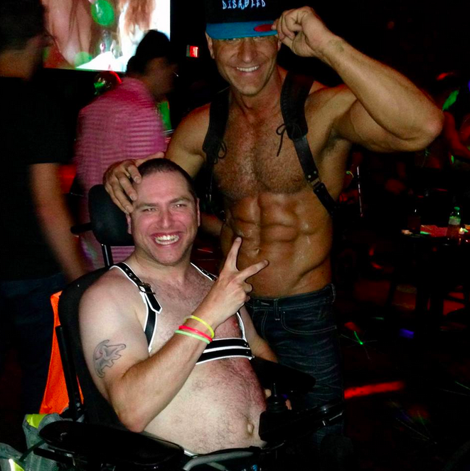 two men dancing at the sex party