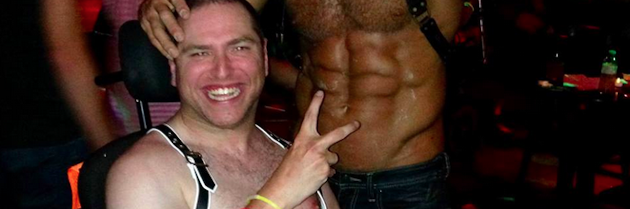 two men at deliciously disabled sex party