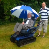 man in wheelchair designed like a tank