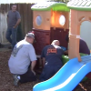 police officers re-assemble children's playset