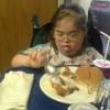 Girl with Down syndrome eating food