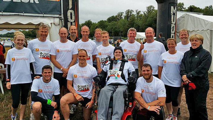 rob camm with teammates and supporters at tough mudder challenge