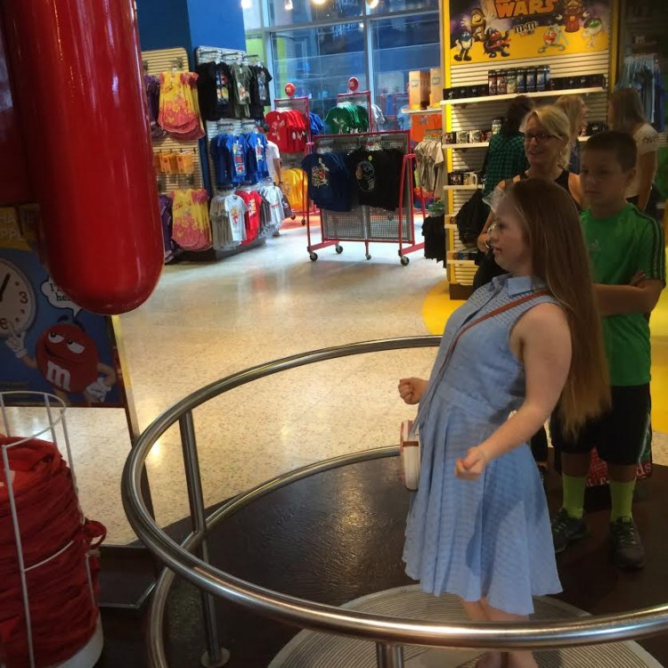 Madeline Stuart inside the M&M store in Times Square