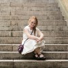 Madeline Stuart sitting on stairs