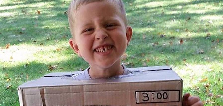 boy wearing microwave costume