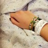 woman's arm wearing hospital wristband