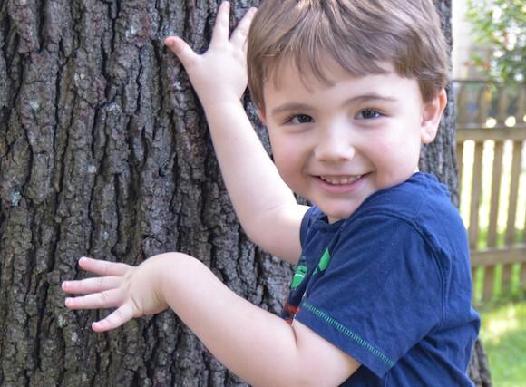 boy next to tree