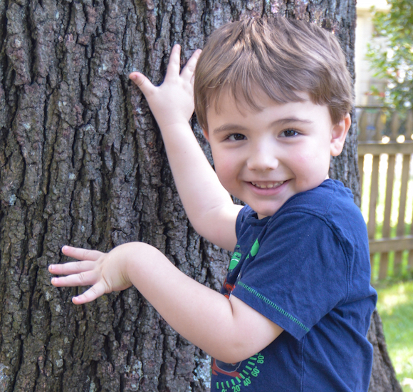 boy next to tree